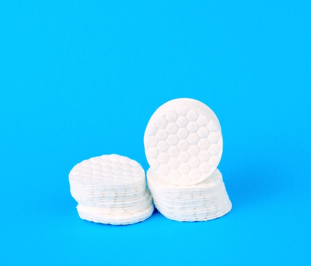 Stack of white cotton round discs for cosmetic procedures