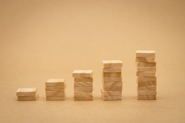 Stack of wood businessmen standing investment analysis or investment.