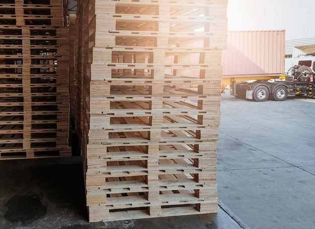 Stack of wooden pallets for industrial warehouse and freight transportation.