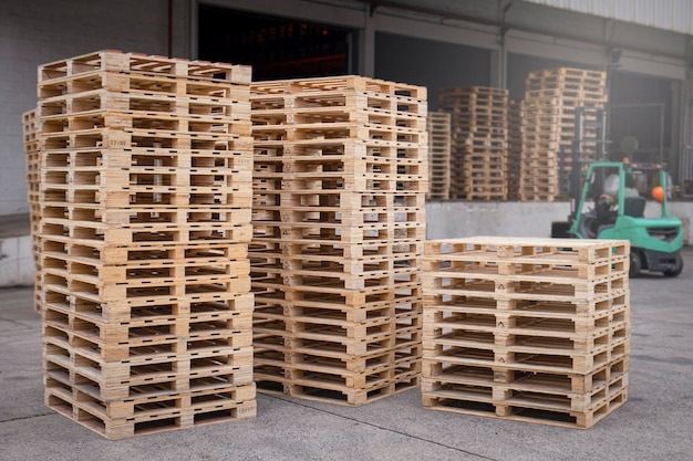 Stack of wooden pallets rack at storage warehouse.