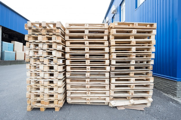 Stack of wooden pallets in stock