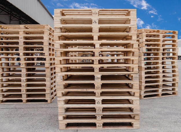 Stack of wooden pallets storage at manufacturing factory warehouse.