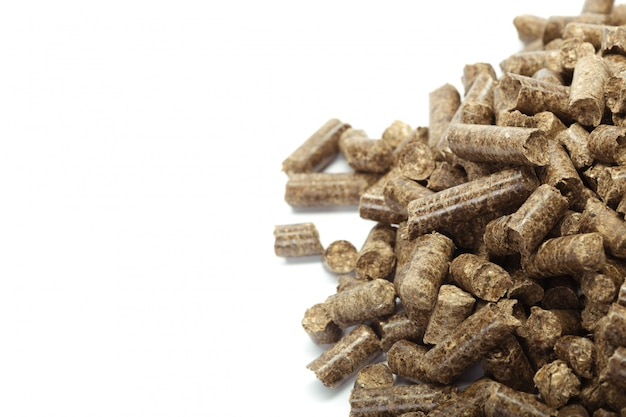 Stack of wooden pellets for bio energy, white background, isolated