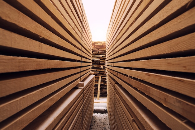 Stack of wooden planks in sawmill lumber yard