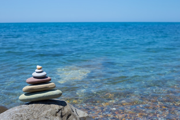 Stack of zen stones near sea. harmony, balance.