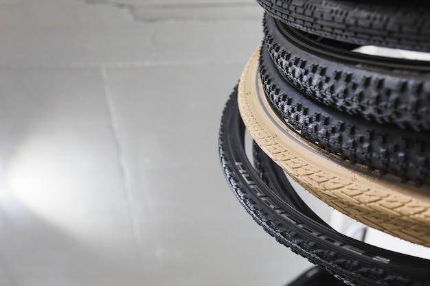 Stacked bicycle tires in workshop