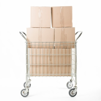 Stacked of cardboard box on trolley against white background