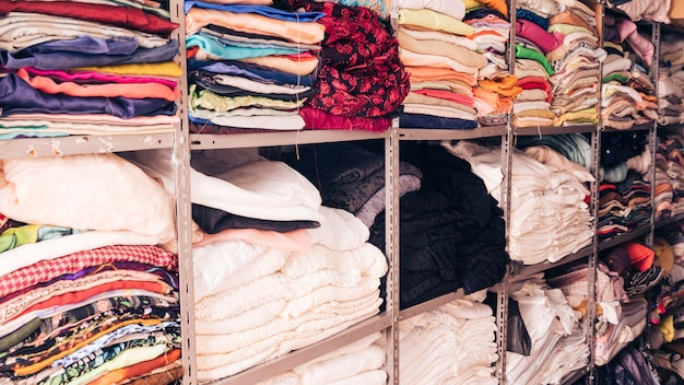 Stacked of colorful fabrics in the shelf