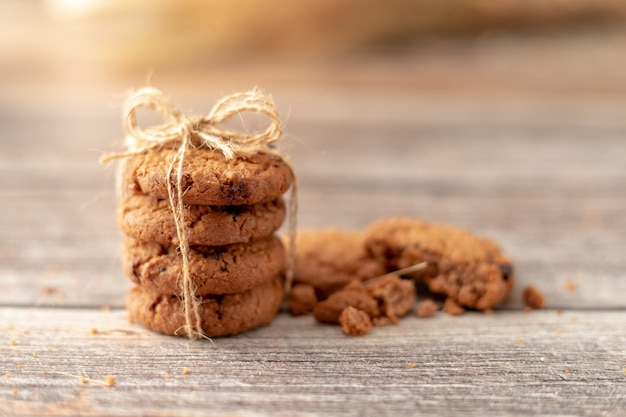 Stacked cookies use a rope tied on a wooden table
