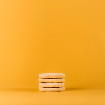 Stacked cookies on yellow background