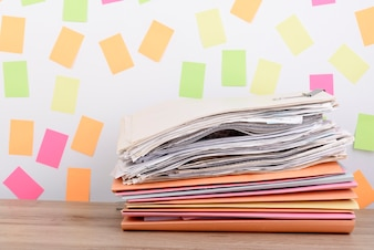 Stacked documents on the office desk,Colorful paper post it the background