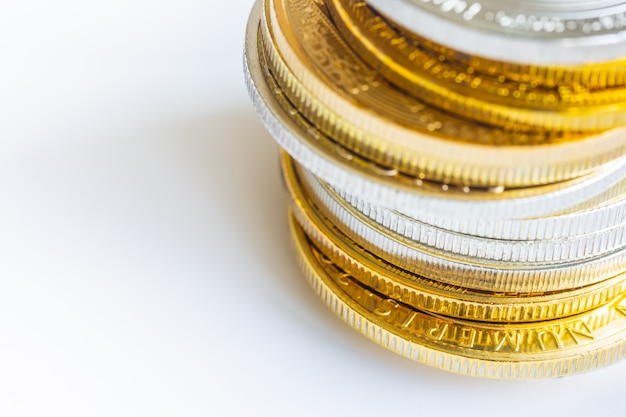 Stacked of golden color coins on white isolated background in close up view.