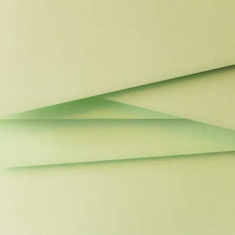 Stacked of green card paper abstract backdrop