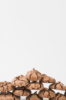 Stacked of homemade dark chocolate cookies isolated on white backdrop