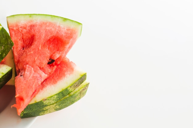 Stacked of juicy watermelon triangular slices isolated on white background
