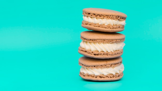 Stacked of macaroons on turquoise background