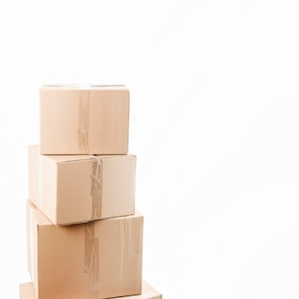 Stacked packages over white background