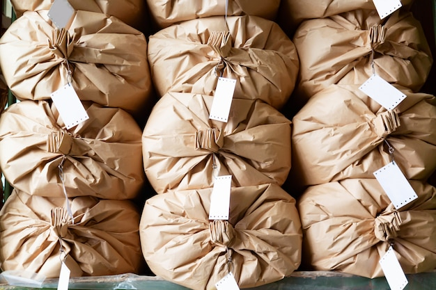 Stacked paper sacks in a warehouse.