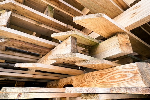 Stacked plates of wood in warehouse for buildings construction