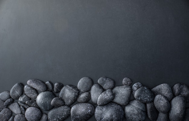 Stacked stones on dark