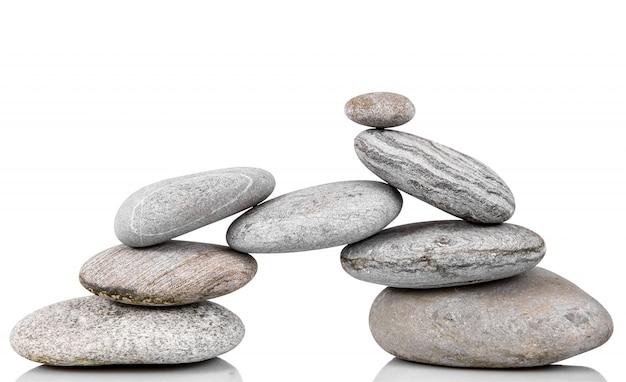 Сложенные камни на белом фоне