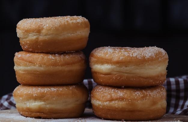 Stacked of sugar donuts