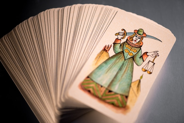 Stacked tarot cards showing justice uppermost