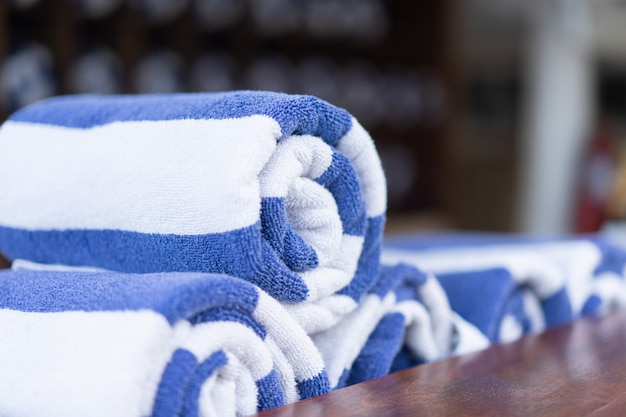 Stacked towel at swimming pool