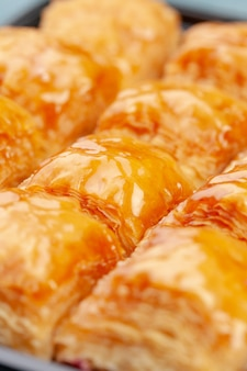 Stacked turkish baklava dessert in a plate close up