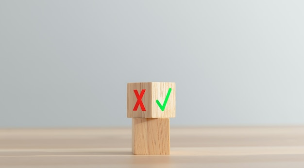 Stacked wooden blocks and false and true symbols