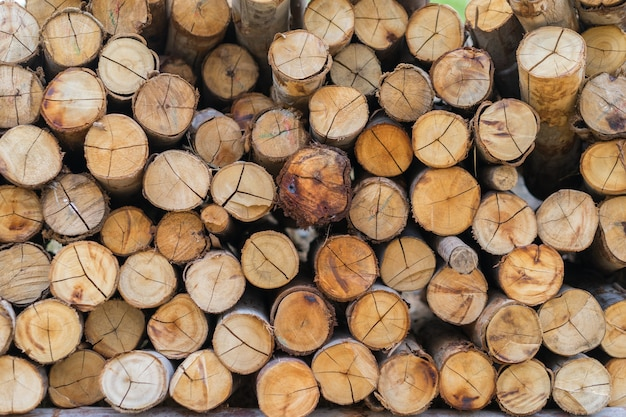 Stacked wooden logs background