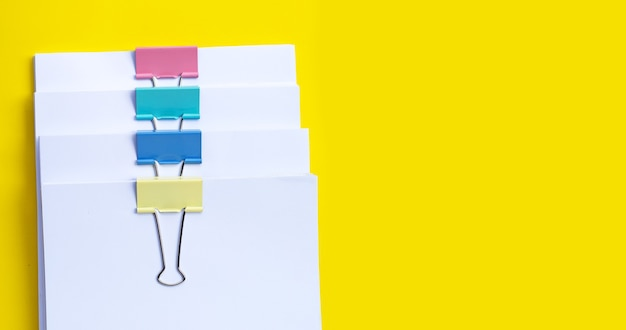Stacking of business document with colorful binder clips. copy space