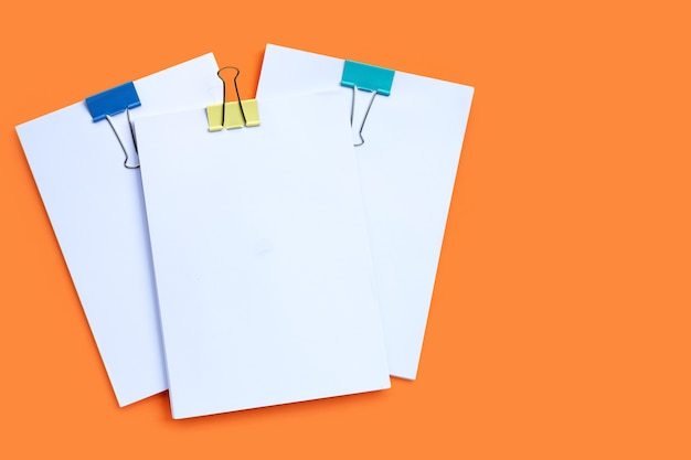 Stacking of business document with colorful binder clips