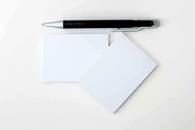 Stacking of mockup empty white business card with elegance pen  on  white paper  , template for business  branding identity
