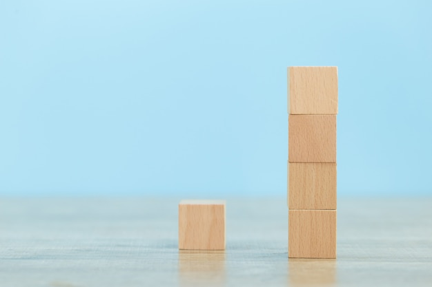Stacking wooden blocks into steps,concept of business growth success