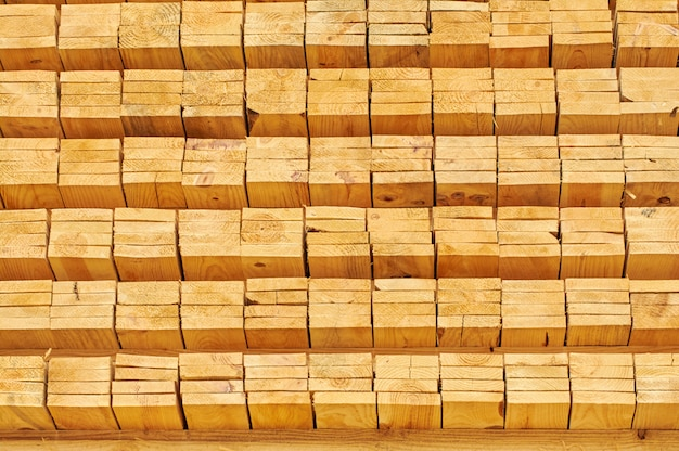 Stacking wooden planks for construction