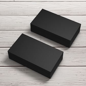Stacks of black blank business cards on a wooden table. 3d rendering