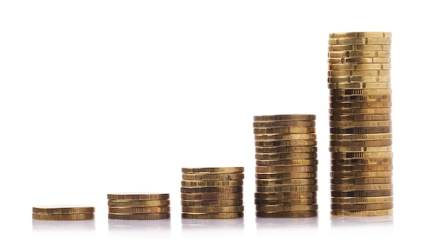 Stacks of coins forming income growth isolated on white background