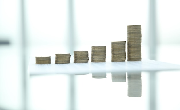 Stacks of gold coins on a blurred background