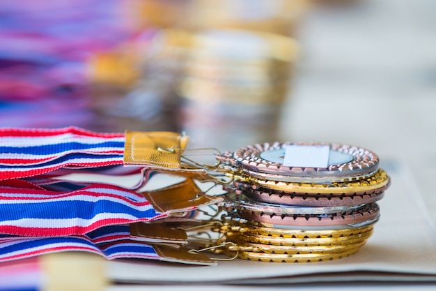 Stacks of gold, silver, and bronze medals