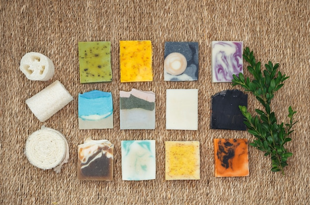 Stacks homemade bars of soap with herbal material. natural soap with spa accessories.