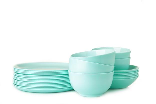 Stacks of mint ceramic dishware isolated on white