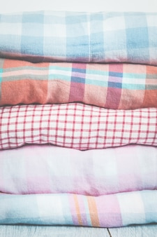 Stacks of multicolor clothing on white background. spring concep