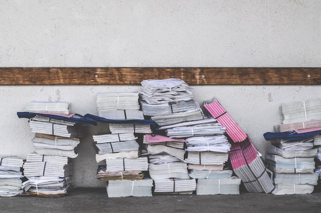 Stacks of newspapers and magazines waiting to be mailed