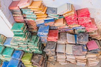 Stacks of colorful glazed square tiles for the use of zellige tilework. Medina of Fez, Morocco.