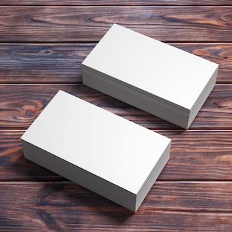 木製のテーブルの上の白い空白の名刺のスタック。 3dレンダリング