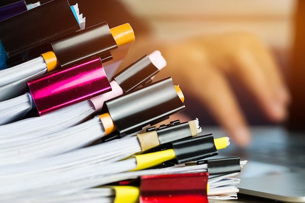 Stacks of papers documents files information business report papers with color clips paper