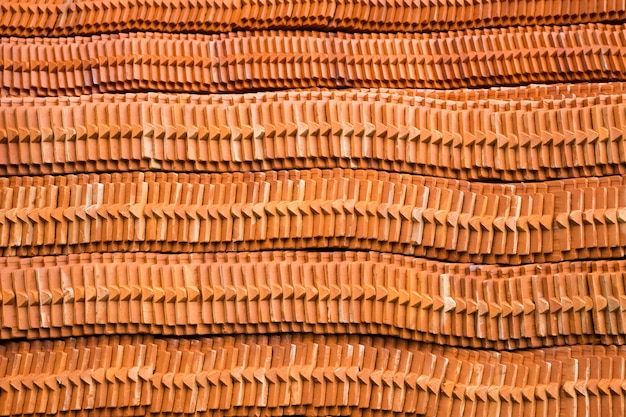 Stacks of roof tiles and patterns.