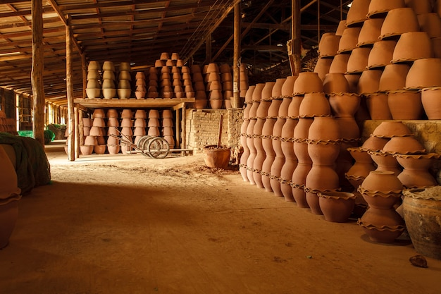 Stacks of terracotta pots in the warehouse