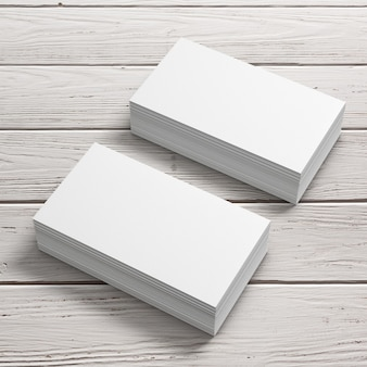 Stacks of white blank business cards on a wooden table. 3d rendering